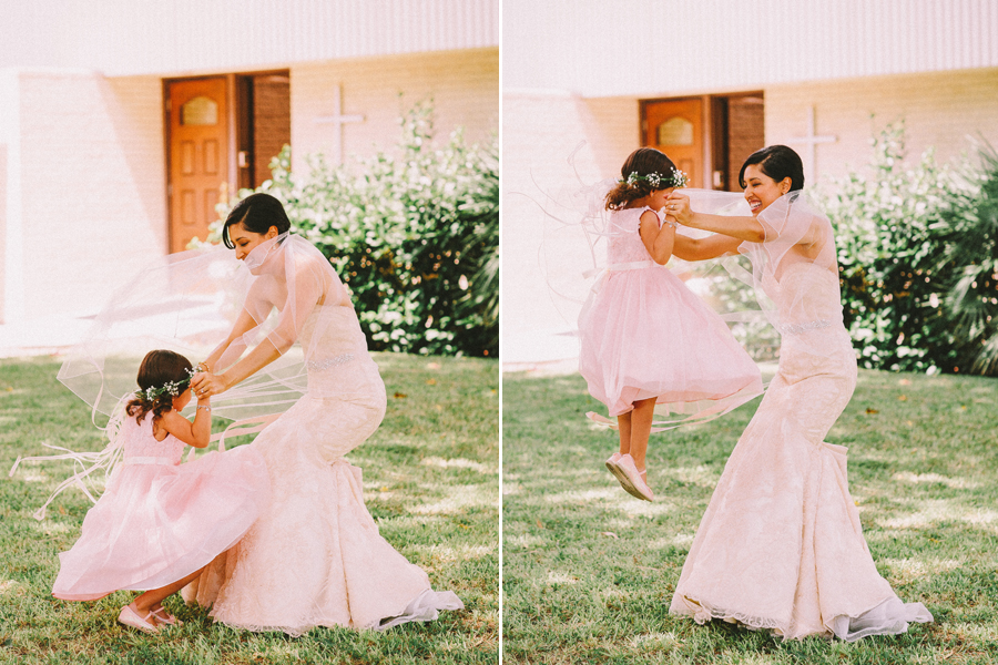 bride playing with flower girl